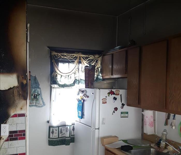 Fire damaged kitchen before.